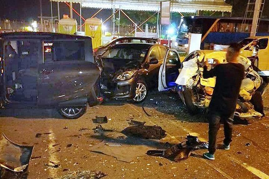 The scene of the multiple-vehicle accident at Woodlands Checkpoint early yesterday morning. A woman in her 60s and a man in his 50s were taken to hospital following the crash.