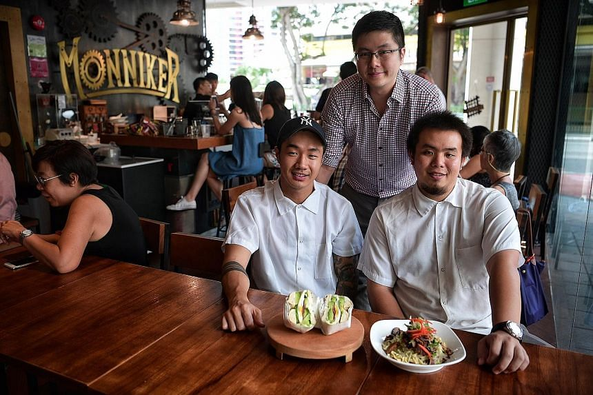 (Seated from far left) Mr Jerome Lam, co-owner of Two Men Bagel House and Mr Jonathan Ong, a former head chef at SPRMRKT Kitchen & Bar, with Monniker Cafe's co-owner, Mr Tia Siew Jun (standing).
