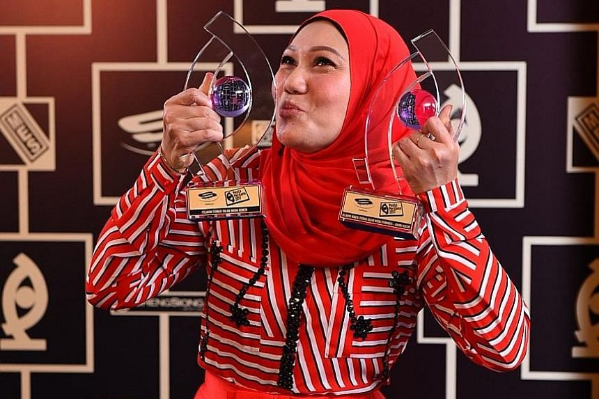 Actress Mastura Ahmad picks up Best Actor/ Actress In A Comedy Role for her part in Anak Bulan and also Best Actress In A Supporting Role (Drama Series) for Interns Season 1.