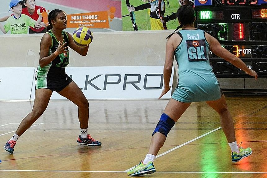 Shanna Dringo (left) of Papua New Guinea was one of two foreign players who played in the Magic Marlins' 66-42 win over the Tiger Sharks during the first day of Round Two Netball Super League matches. Papua New Guinea defender Kilala Owen also featur