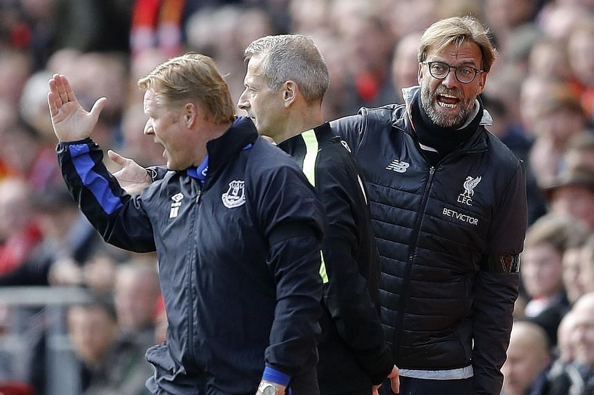 Everton manager Ronald Koeman (left) and Liverpool counterpart Jurgen Klopp (right) react during a passionate Merseyside derby at Anfield. The hosts won 3-1 but lost key forward Sadio Mane to injury.