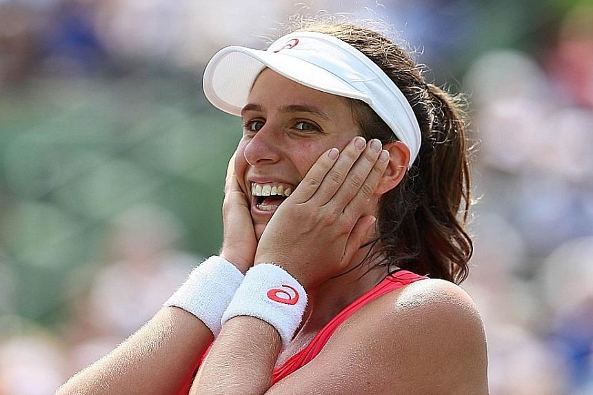 A joyous Johanna Konta after defeating Caroline Wozniacki in Key Biscayne, Florida. With No. 1 Angelique Kerber in patchy form and No. 2 Serena Williams injured, the women's field is wide open for the challengers.