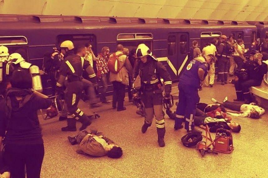 Emergency personnel attend to the injured after a blast at a St Petersburg metro station.
