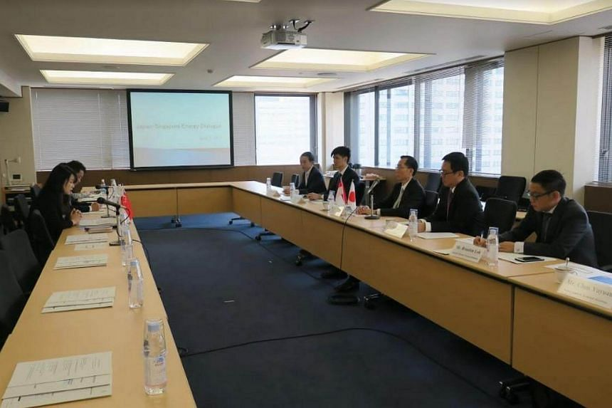 Mr Ng Wai Choong (centre; right row), chief executive of Singapore's Energy Market Authority, speaks at the first Japan-Singapore Energy Dialogue held on Monday, April 3, 2017, in Tokyo.