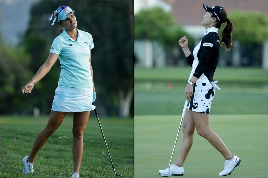 Lexi Thompson (left) reacts to her second shot from the rough on 18th hole, while in a playoff with So Yeon Ryu during the final round of the ANA Inspiration at the Dinah Shore Tournament Course at Mission Hills Country Club on April 2, 2017