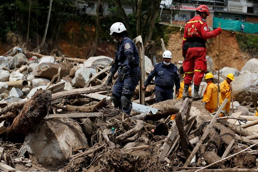 Rescuers look for bodies in a destroyed area after flooding and mudslides caused by heavy rains in Mocoa, Colombia April 2, 2017.