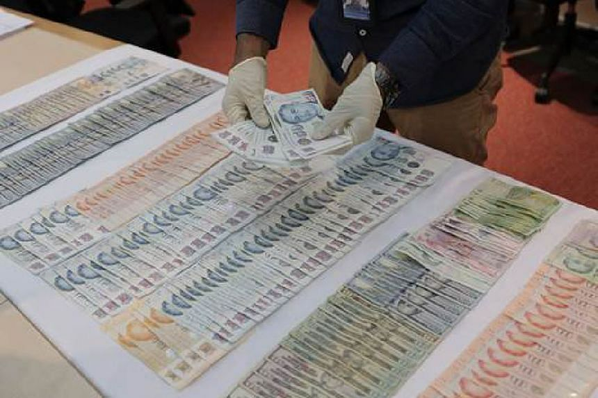 Police seized money from the three Romanians, including Singapore currency amounting to $4,996, US currency amounting to $5,980 and other currencies including Turkish lira, pounds and euros.