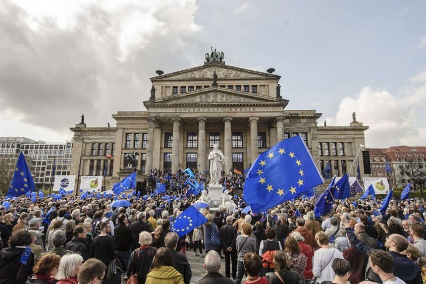 People waving European Union (EU) flags at a pro-European Union rally titled at the Gendarmenmarkt square in Berlin, Germany, on April 2, 2017.