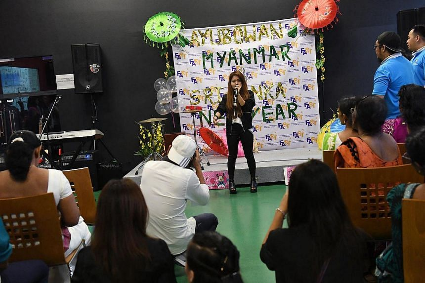 Myanmar domestic helper Margaret Mawi, 27, belting out a rock tune at the Foreign Domestic Worker Association for Social Support and Training new year celebration for Myanmar and Sri Lankan domestic workers in Singapore.