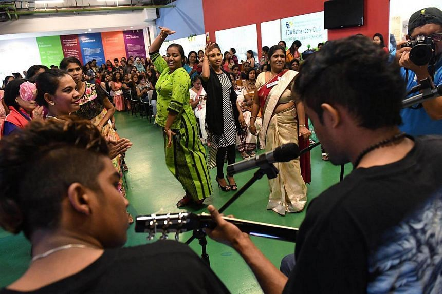 Domestic workers enjoying themselves at the new year celebration.