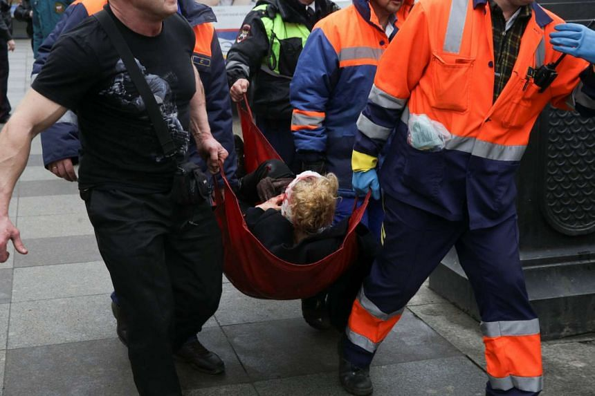 Russian emergency services personnel carrying an injured person outside Sennaya Ploshchad metro station, following two explosions on the metro, in St Petersburg, Russia, on April 3, 2017.