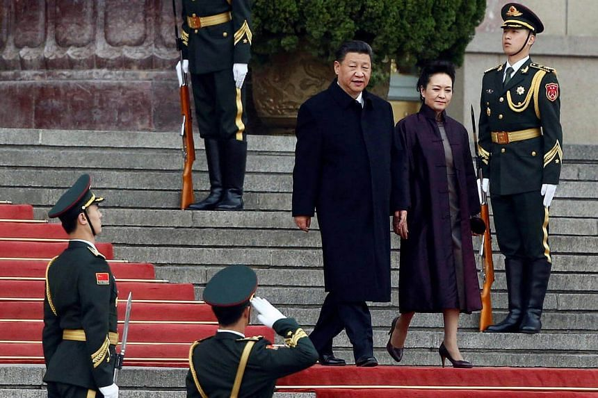Chinese President Xi Jinping and First Lady Peng Liyuan attend a welcoming ceremony for Serbia's President Tomislav Nikolic (not pictured) at the Great Hall of the People in Beijing, China, on March 30, 2017.