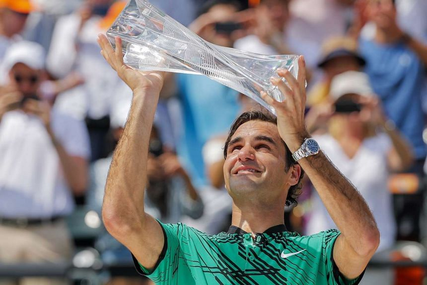 Roger Federer holds the winner's trophy after defeating Rafael Nadal to win the Miami Open on April 2, 2017.