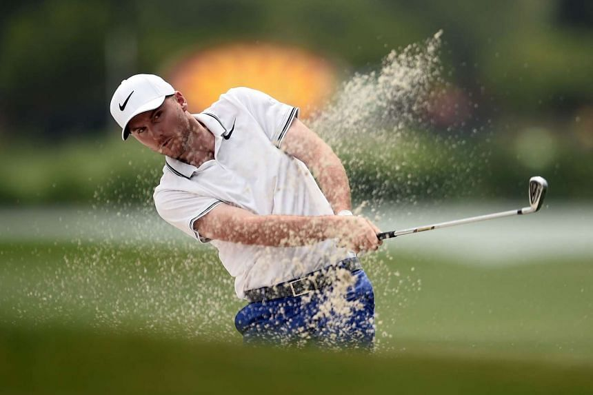 Russell Henley plays his second shot on the 18th hole during the final round of the Shell Houston Open on April 2, 2017