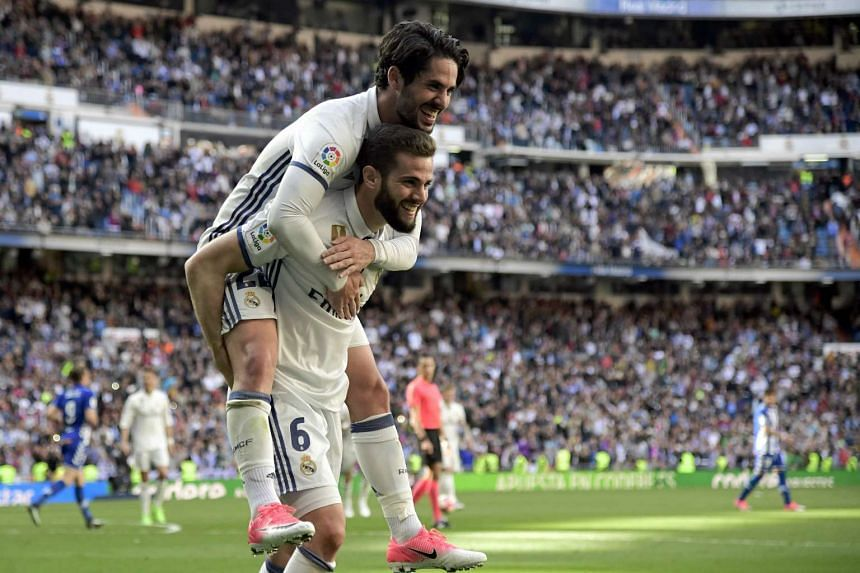 Real Madrid's Nacho Fernandez celebrates a goal with Isco in Madrid on April 2, 2017.