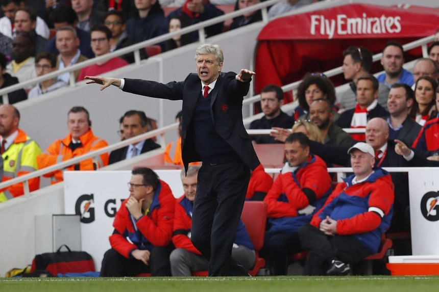 Arsenal manager Arsene Wenger gestures on the sidelines of the match against Manchester City.