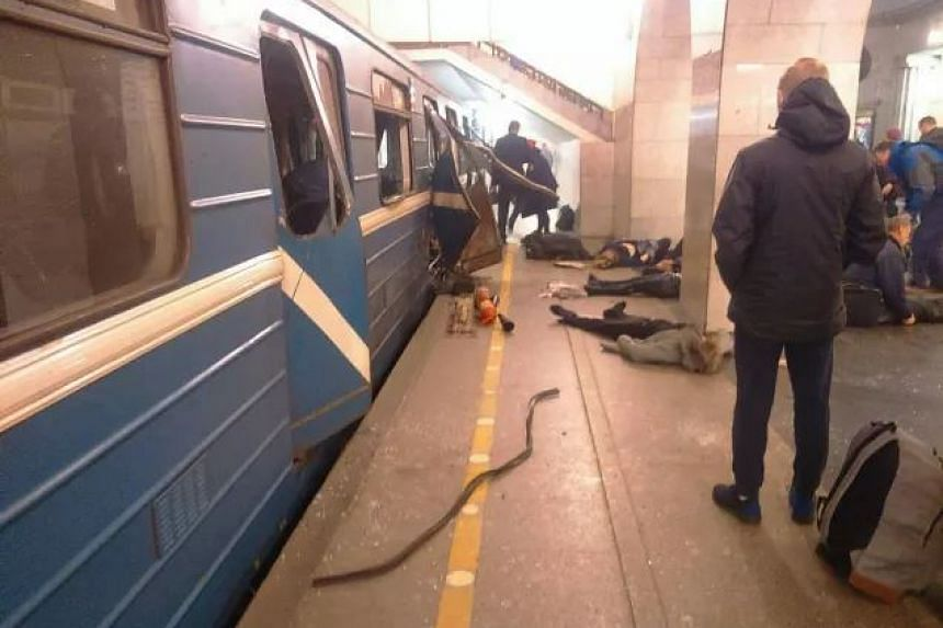 Injured people wait for assistance in the aftermath of a blast in a St Petersburg metro station on April 3, 2017.