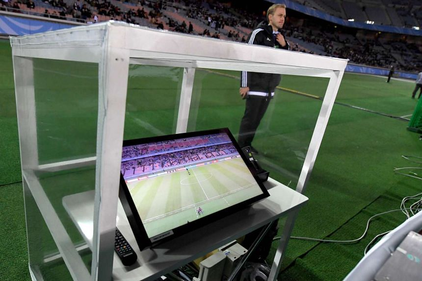 A video assistant referee system placed beside the pitch prior to the Club World Cup semi-final football match between Mexico's Club America and Spain's Real Madrid in Yokohama.