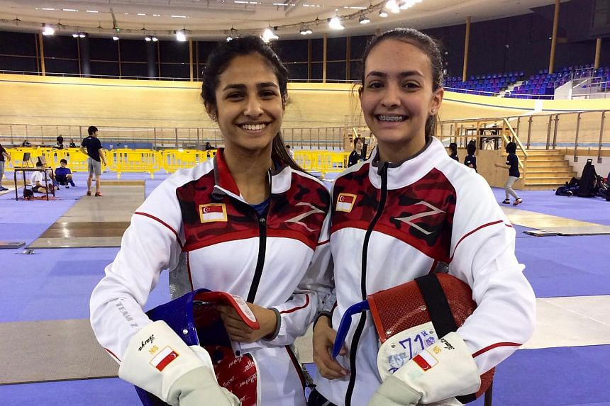 Amita Berthier (right) and her sister, Aarya, during a warm-up session before the Fencing Cadet and Junior World Championships in Bourges, France, on April 1, 2016.