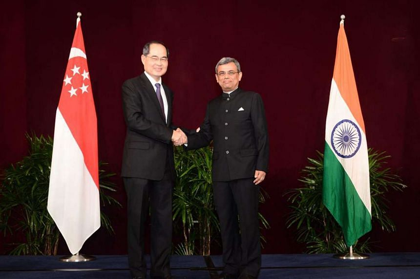 Singapore's Minister for Trade and Industry (Trade) Lim Hng Kiang (left) shaking hands with High Commissioner Jawed Ashraf at the reception to celebrate India's 68th Republic Day held at the Shangri-La Hotel on Jan 26, 2017.