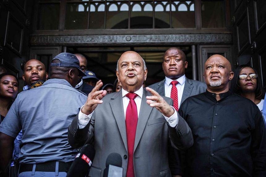 Former South African Finance Minister Pravin Gordhan (centre) address a group of supporters outside the South African National Treasury in Pretoria.