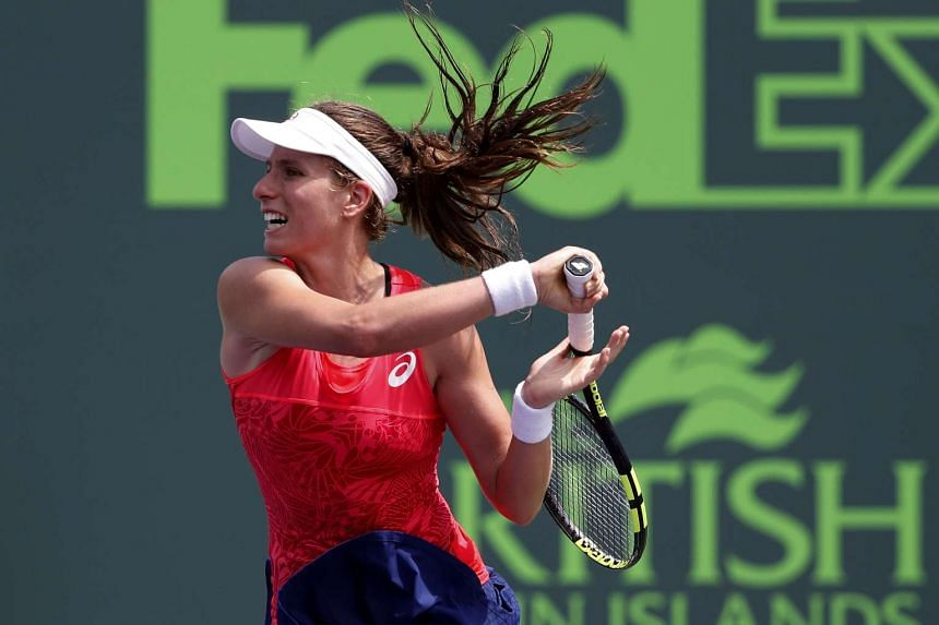 Johanna Konta of Great Britain hits a forehand against Caroline Wozniacki of Denmark (not pictured) in the women's singles championship of the 2017 Miami Open at Crandon Park Tennis Center.