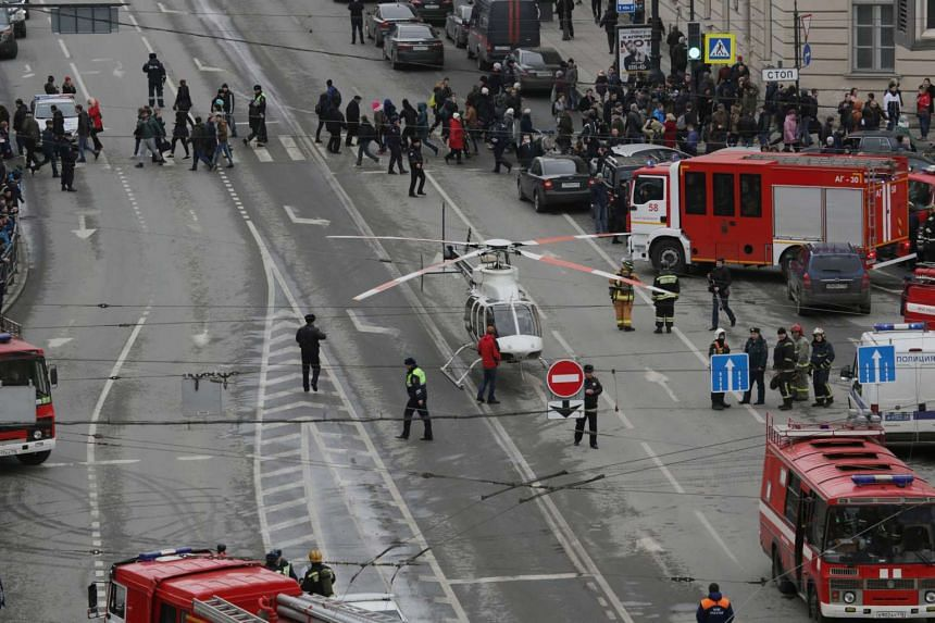 General view of emergency services attending the scene outside Sennaya Ploshchad metro station, following explosions in two train carriages in St Petersburg