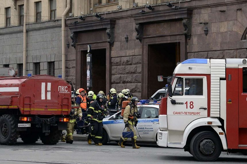 Emergency services personnel walking at the entrance of the Technological Institute metro station in St Petersburg, on April 3, 2017.