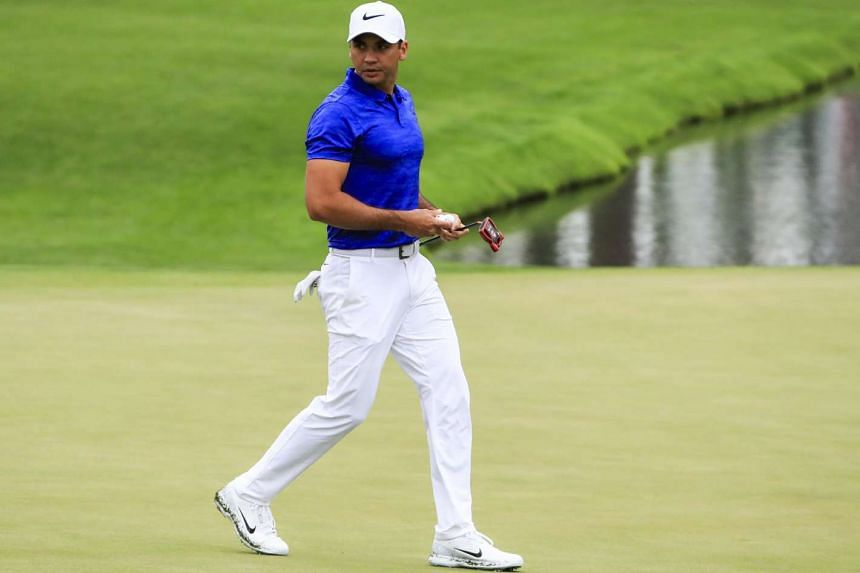 Jason Day of Australia walks across the sixteenth green during a practice round on the course at the 2017 Masters Tournament at the Augusta National Golf Club in Augusta, Georgia, US, April 3, 2017.