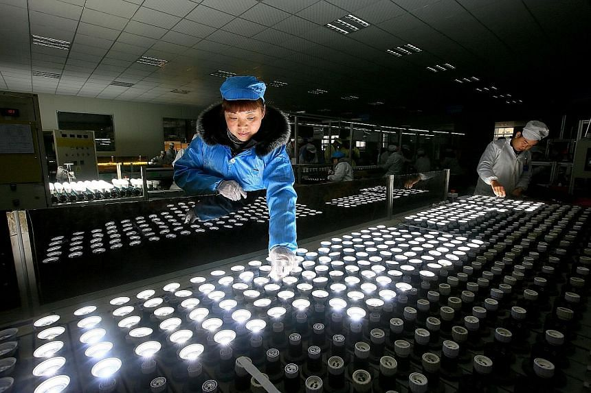 Chinese employees at a lighting factory. China led the way in what was a strong quarter for the world's manufacturers, with its official manufacturing index expanding at the fastest pace in nearly five years. Higher commodities prices and global dema