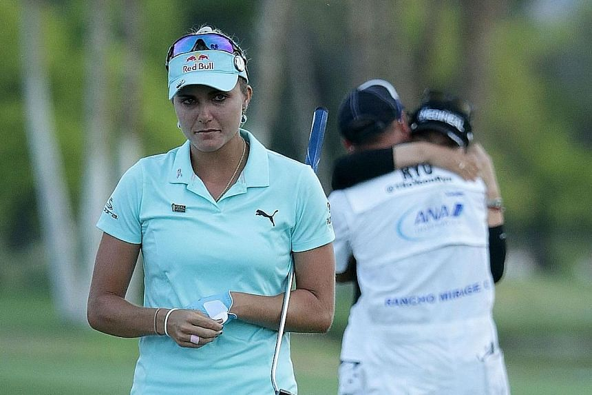 A heartbroken Lexi Thompson walking off the 18th green, as Ryu So Yeon celebrates her second Major title with her caddie after winning the first play-off hole at Mission Hills Country Club.