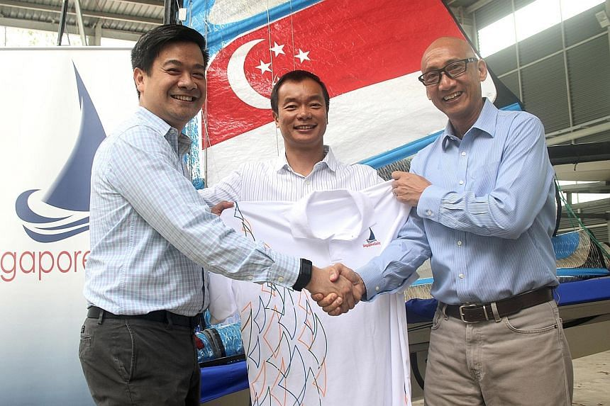 Lim Han Ee (left) took over from Andrew Tam (right) at the helm of SingaporeSailing yesterday. With them is the association's president Ben Tan.