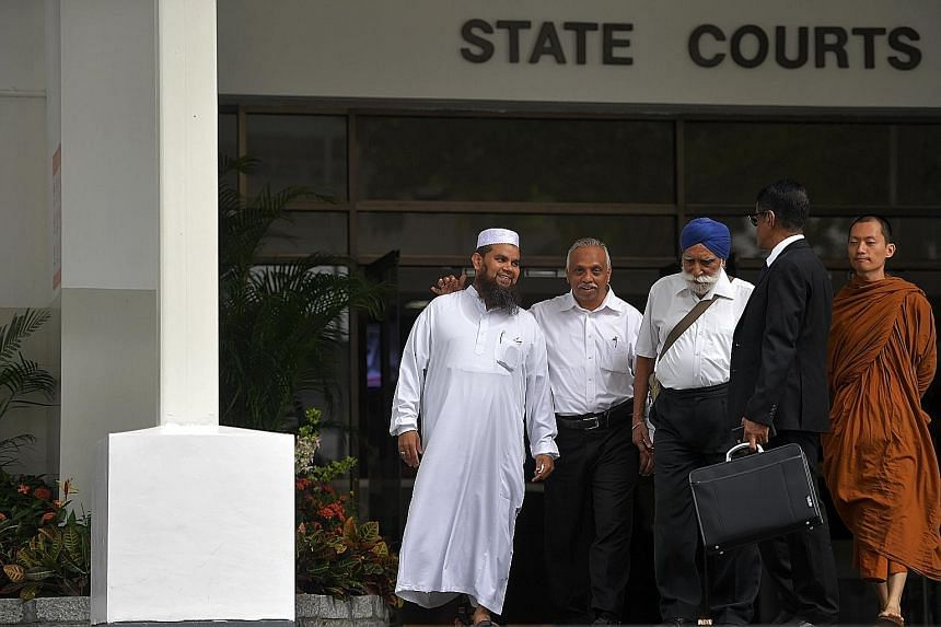 """Imam Nalla Mohamed Abdul Jameel leaving court yesterday with religious leaders Haja Maideen of the United Indian Muslim Association, Harbans Singh and Phra Goh Chun Kiang, and lawyer Noor Mohamed Marican. In sentencing, the judge noted the imam's """"st"""
