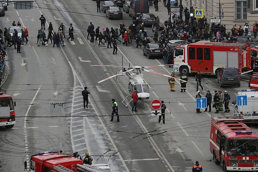 Emergency vehicles and workers outside the Sennaya Square station in St Petersburg after the blast yesterday. While one official said the blast showed all the signs of a terror attack, President Vladimir Putin said it was too early to speak about the