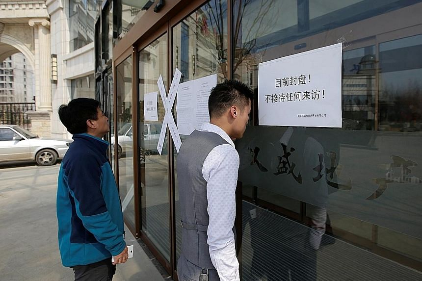 """A """"closed"""" sign at a real estate office yesterday as the Chinese government bans new property sales in counties earmarked as part of a new special economic zone in Xiongan, Hebei province."""