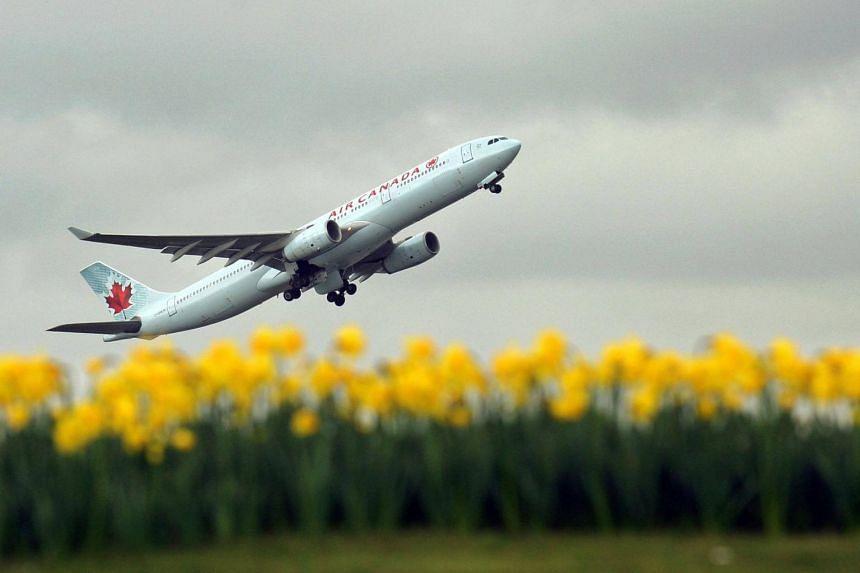 An Air Canada plane taking off from London Heathrow Airport.