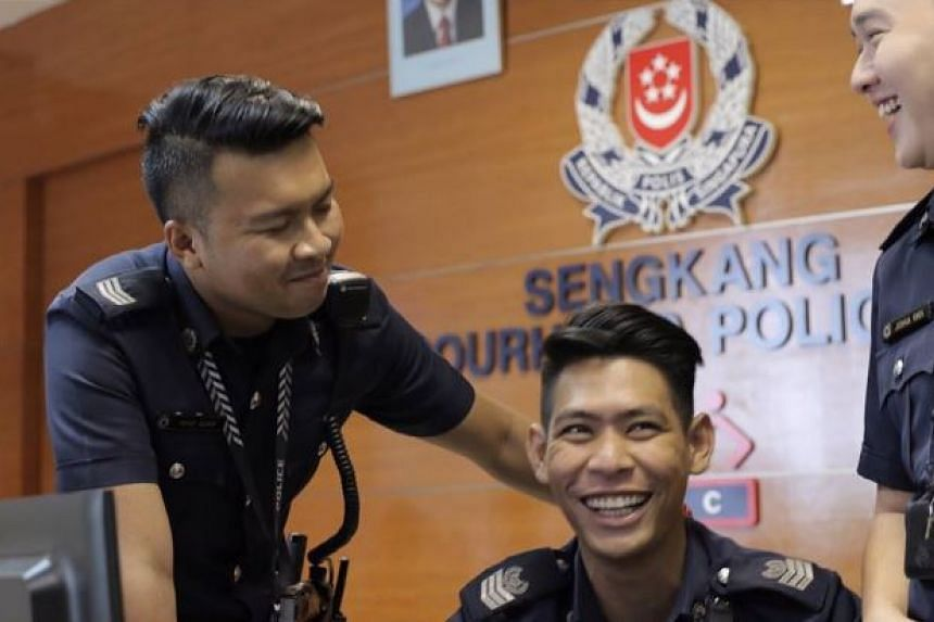 Senior Staff Sergeant Mohamad Azhar Abdul Aziz (centre), who said the boy reminded him of his daughter, performed chest compressions to revive him.