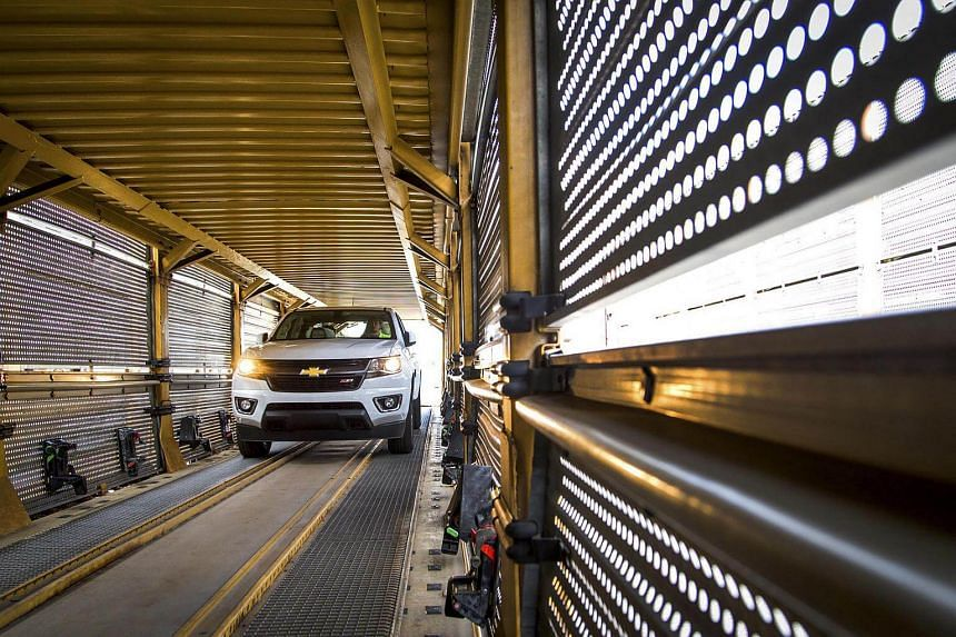 A 2015 Chevrolet Colorado loads onto a carrier for shipment to dealers, at the General Motors assembly plant.