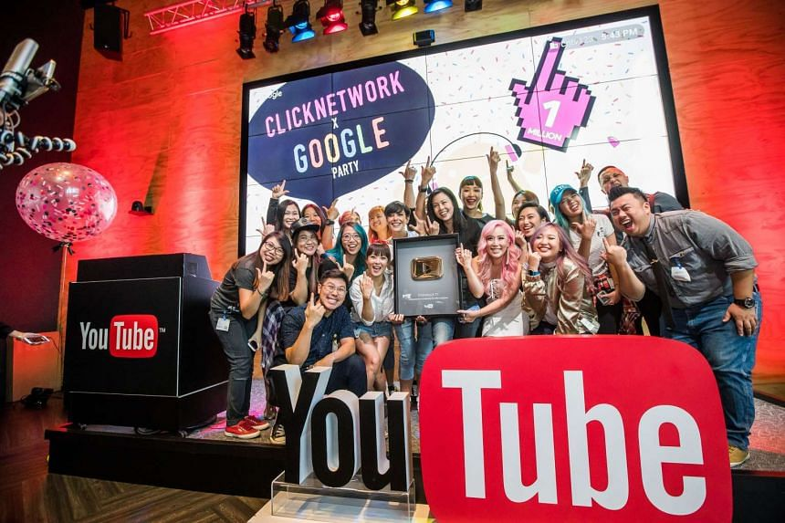 The hosts and crew of Clicknetwork receiving Singapore's first Gold Play Button.