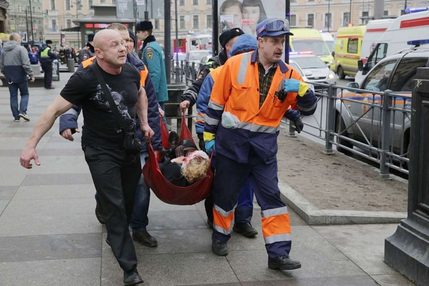 Russian rescuers carrying a victim of the metro blast at the Tekhnologichesky Institute station in St Petersburg on April 3, 2017.
