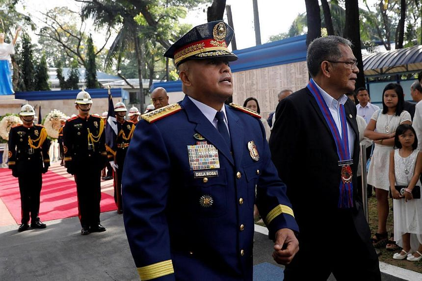 Philippine National Police chief Ronald dela Rosa (left) walks with former Department of Interior and Local Government secretary Ismael Sueno after a wreath-laying ceremony for policemen killed in action, during the Philippine National Police celebra