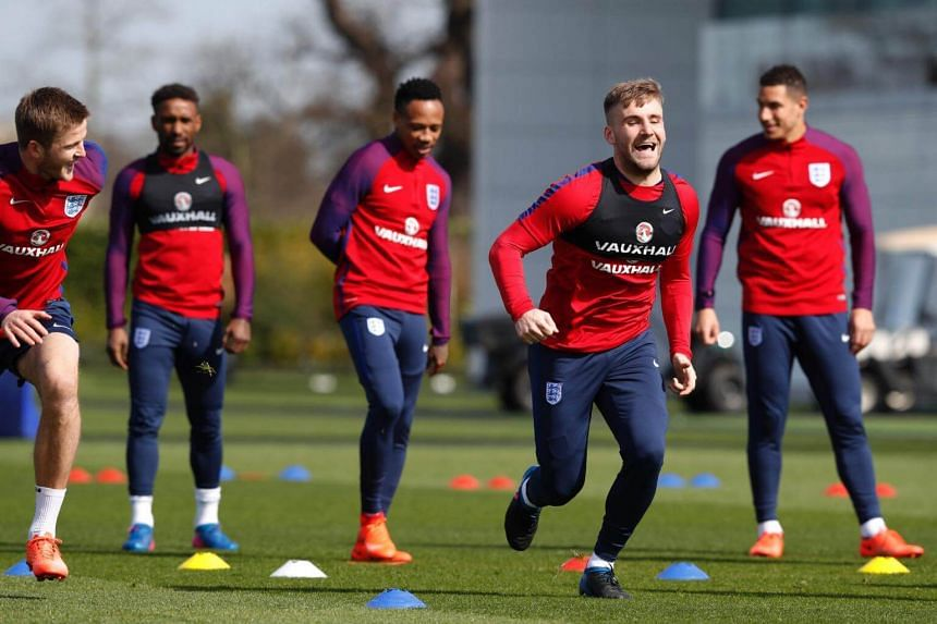 England's defender Luke Shaw (2nd from right) takes part in a training session at Tottenham Hotspur's training complex in Enfield, north London, on March 25, 2017.