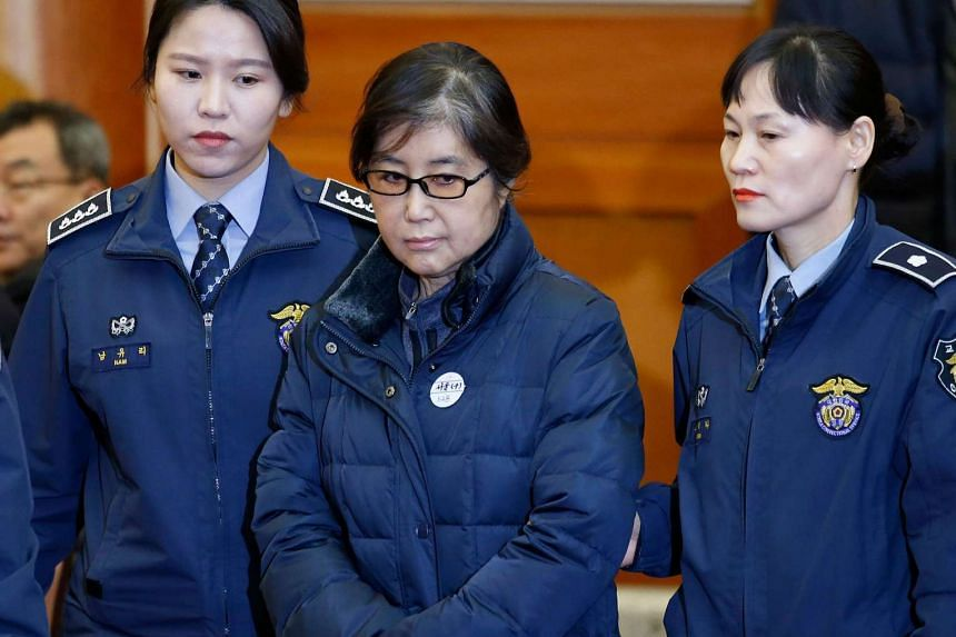 Choi Soon Sil (centre) arrives for hearing arguments for South Korean President Park Geun Hye's impeachment trial at the Constitutional Court in Seoul on Jan 16, 2017.
