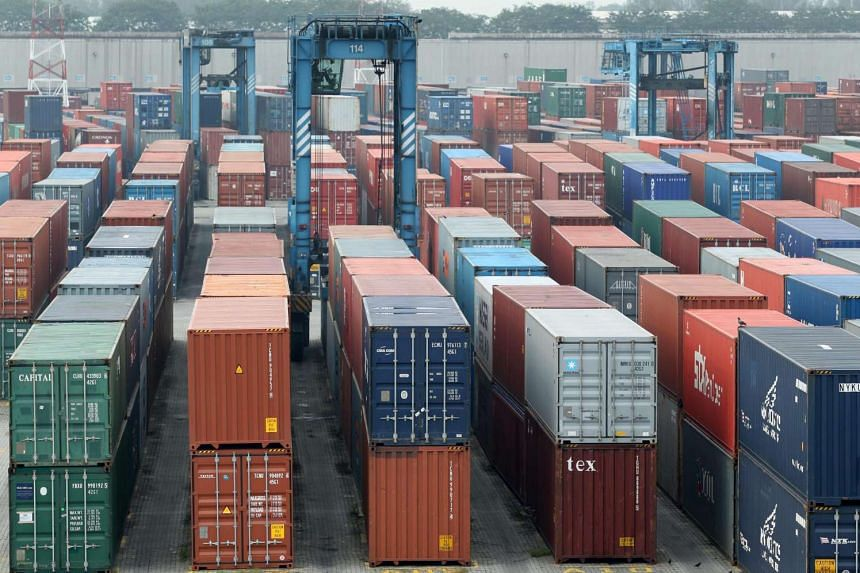 Shipping containers are stacked at North Point in Port Klang, Selangor.