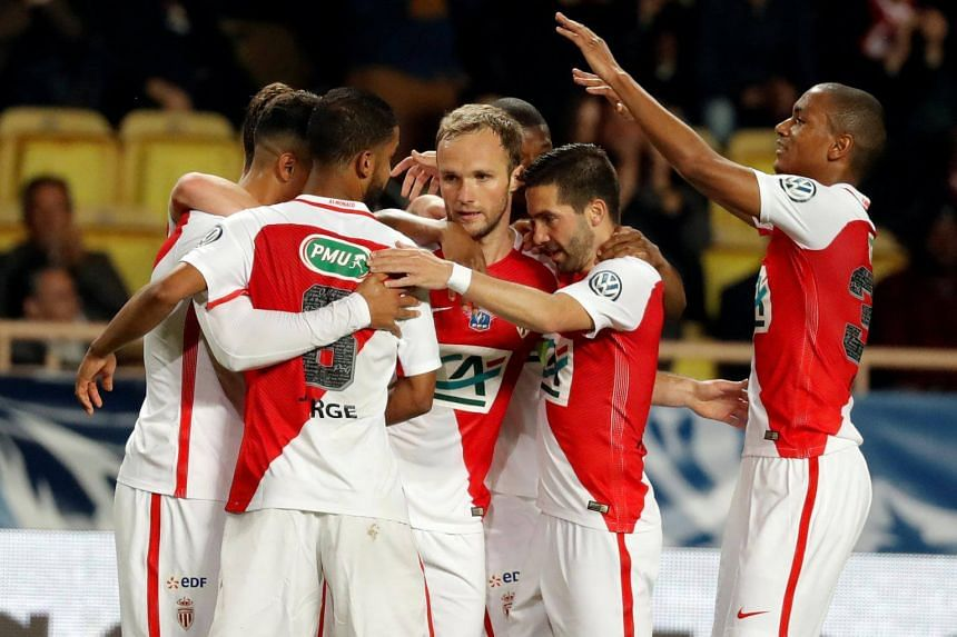Monaco players celebrate after the win against Lille on April 4.