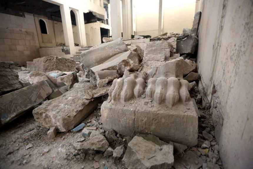 The remains of lamassu statues and winged lions in Mosul Museum which were destroyed by ISIS fighters.