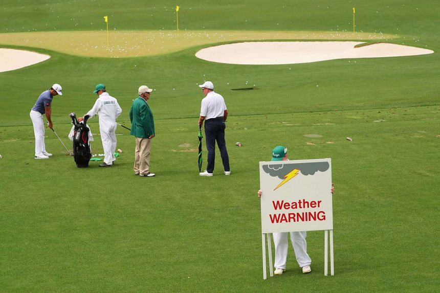 Signs indicating that play is suspended due to inclement weather are displayed at Augusta National Golf Club on April 3, 2017.