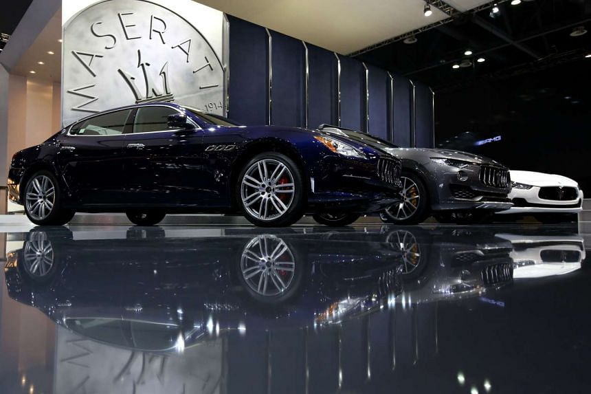 Fiat SpA Maserati vehicles stand on display at the company's booth during the press day of the Seoul Motor Show.
