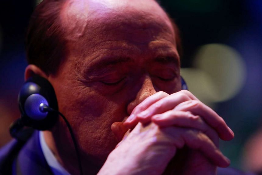 Former Italian Prime Minister Silvio Berlusconi takes part in a European People Party (EPP) summit.