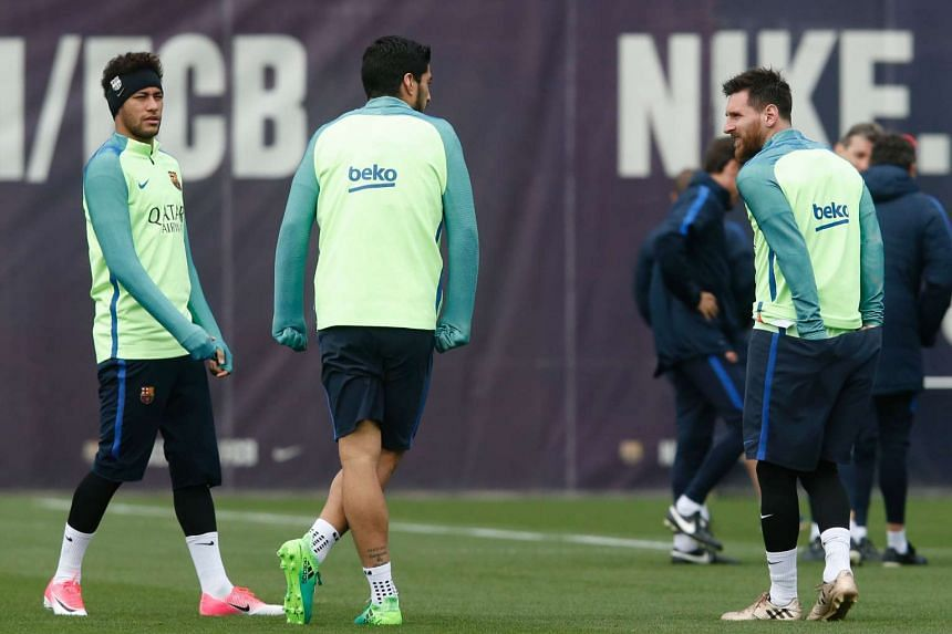 Neymar (left), Luis Suarez (centre) and Lionel Messi take part in a training session.